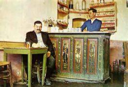 Kαφενείο στην Αγία Παρασκευή Λέσβου. Ο πάγκος ζωγραφισμένος από το Θεόφιλο