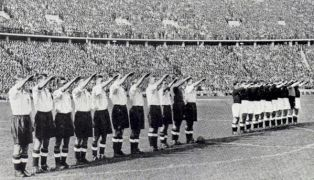England perform a Nazi salute before a game in Berlin. 100,000 fans turned up for the match. 1938